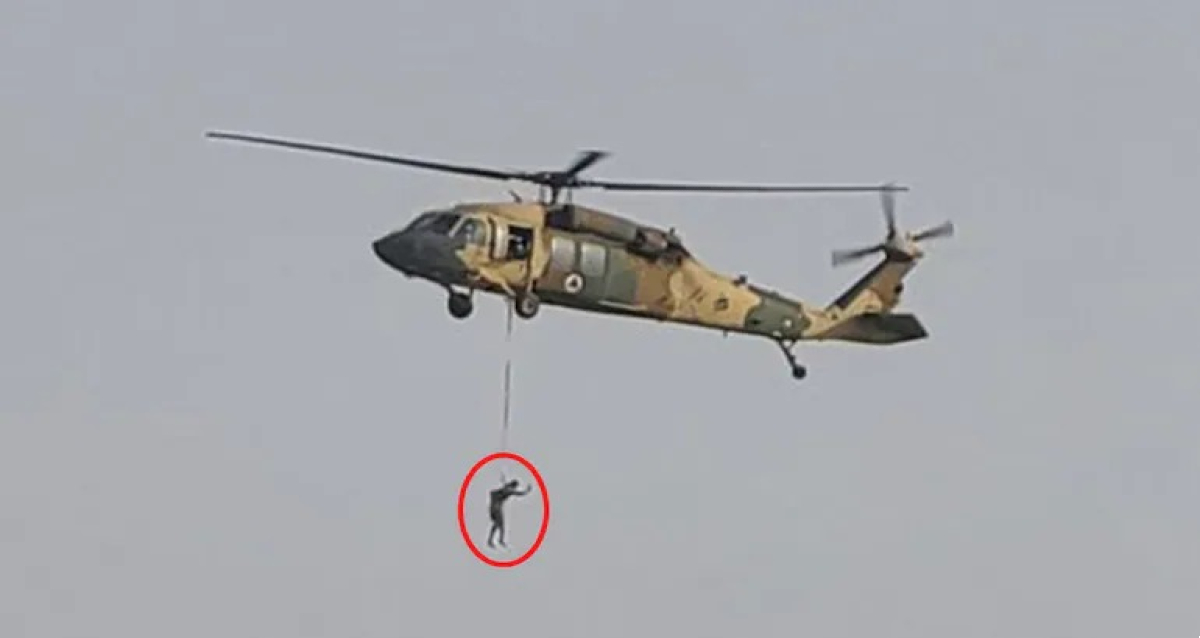 Taliban militants fly US helicopter with man hanging from rope